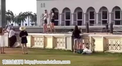 奇葩!中国辣妹爬上国外清真寺大跳性感蹈!逼停世界著名景点